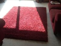 Shaggy pile rug in crimson red