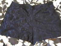 BLUE SHORTS WITH BLACK LACE OVERLAY SAYYS SIZE 20 BUT THEY ARE FROM PRIMARK MORE A 18