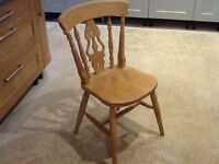 Four solid pine kitchen/dining chairs