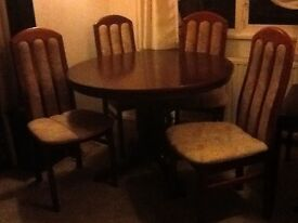 round dinning table with drop leave & 4 chairs