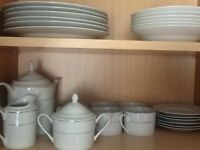 White porcelain dining set and tea set for six place settings for sale. Never used.