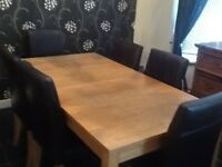 Dining table with 6 leather chairs good condition.