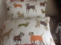 TWO FUN COTTON DESIGNER CUSHIONS SHOWING VARIOUS BREEDS OF DOGS EX COND