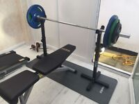 Available is a Barbell, Bench and Weight Set