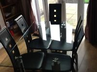 Glass dining table and 6 leather chairs for sale