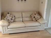 three peice suite cream leather 2x three seater and a chair in very good condition