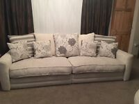 Four seater sofa with cuddle chair and pouffe