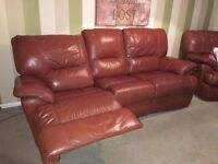 LEATHER RECLINING SOFA AND MATCHING ARMCHAIR