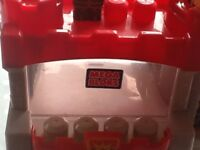 Mega blocks castle, and bag of mega blocks bricks.