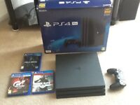 PlayStation PS4 Pro 1TB console (black), 3 games and extra controller (boxed)