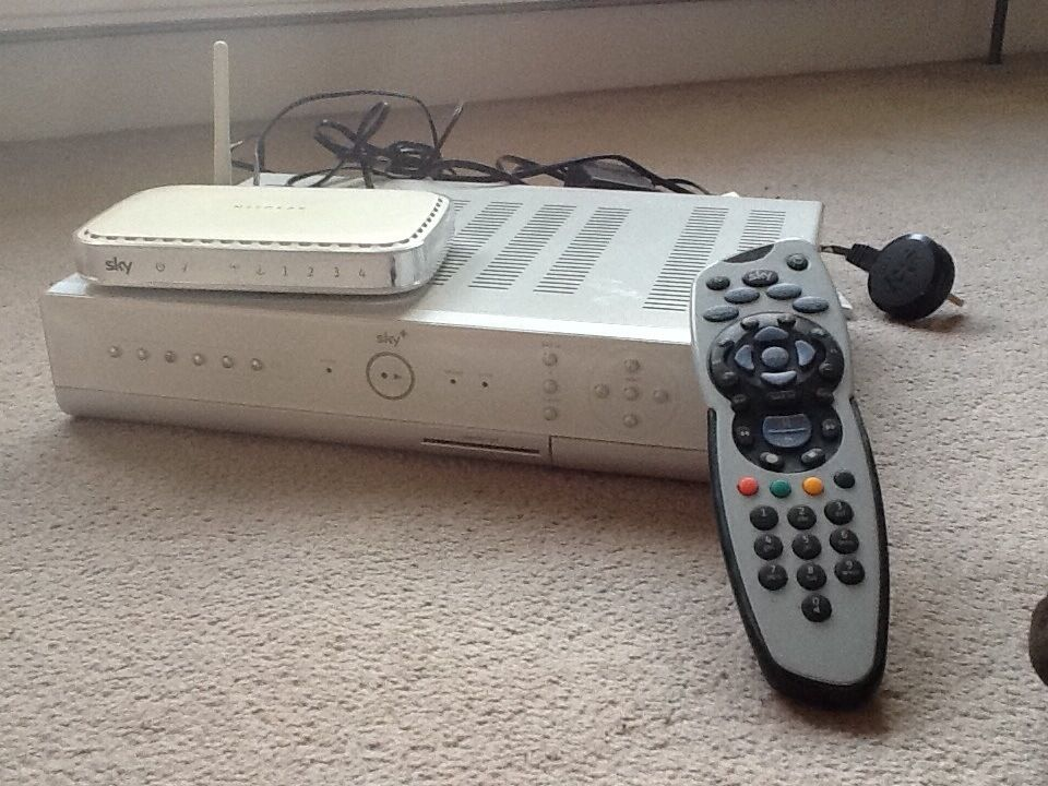 Sky box with remote, cables and router