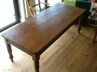 Old pine dining table. Seats 8. Non smoking home. Very good condition .