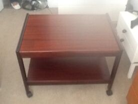 Trolley table in dark wood with wheels good condition