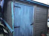 Free. Sectional concrete shed with 1 perspex window.