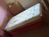 A pine single bed and mattress. Very good condition.