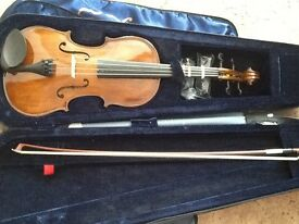 Forenza viola 15' in case with a bow and shoulder rest.