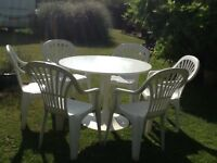 Table and 6 chairs ideal for garden/ conservatory