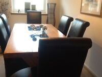 Dining table, solid oak and 6 black leather chairs