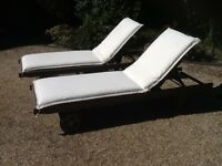 2 wooden recliner loungers with cushions
