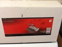 Brand new in box. Comb binding machine