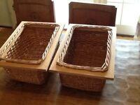 Two kitchen storage baskets, wicker