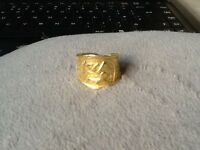 gold ring, unsure if 14 ct or 18 ct as Egyptian gold