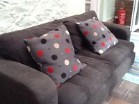 DFS suite. Black 3 seater 2 seater and arm chair with big cushions