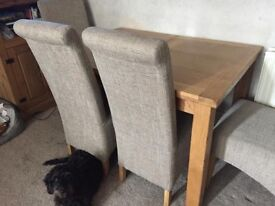 Chrysties extending oak dining table and chairs