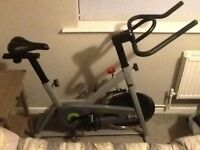 As new only a month old silver and black spin exercise bike