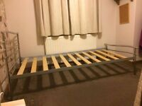 Single metal framed bed with wooden slats - excellent condition