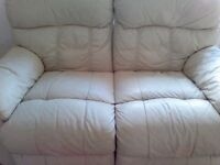 Cream two seater recliner sofa for £30