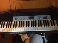 CASIO CTK-1550 WITH STAND AND HEADPHONES