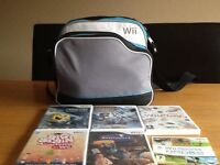 White nintendo wii. Controllers and games