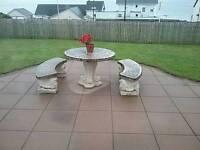 Circular stone garden table and bench set