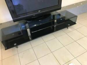BLACK TV STAND GLASS AND LG TV