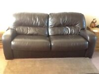 Two brown leather sofas and storage footstool