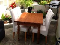 Solid pine table and 4 faux leather high backed chairs in excellent condition