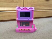 A PIXEL CHIX TOWN HOUSE ELECTRONIC INTERACTIVE TOY, THE MORE YOU PLAY THE HIGHER LEVEL YOU CAN GO