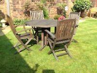 Teak folding gate leg table and 4 chairs.
