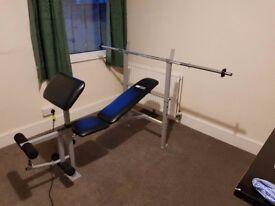 Weights bench, barbell, leg curler, preacher pad and bench press rack