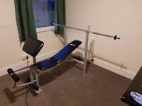 Weights bench, barbell, leg curler, preacher pad and bench press rack