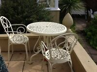 Lovely good quality garden table and 2 chairs