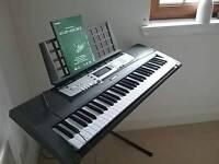 Yamaha EZ200 keyboard and stand