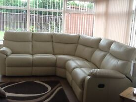 Cream leather recliner corner suite, sits 5, in immaculate new condition, rrp £1700