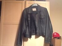 Ladies short leather jacket. Great condition with buttons up fron & 2 pockets