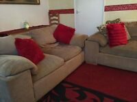 Two seaters sofas with footstools