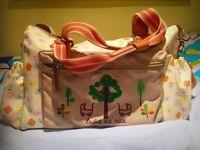 Pink lining twice as nice baby bag