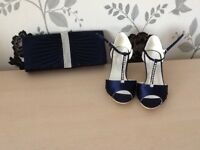 Navy blue shoes and matching clutch bag
