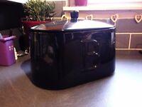 Black ceramic bread bin.