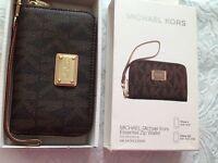 Genuine Michael kors monogram zip purse -£35